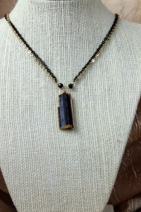 Black tourmaline shard on gold and black chain