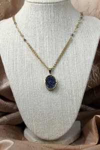 Cobalt drusy pendant on gold necklace