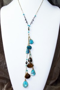 Gemstone fantasy lariat on gold chain