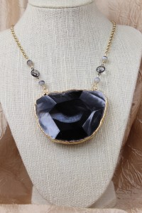 Large faceted agate pendant on gold necklace
