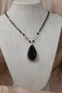 Large faceted teardrop onyx pendant on gold necklace