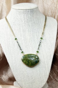 Large green turquoise pendant on gold necklace