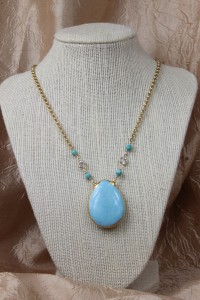 Large turquoise teardrop pendant on gold necklace