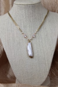 Mabe pearl pendant on gold necklace
