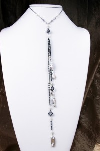 Mabe pearls on long silver necklace