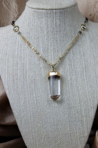 Quartz pendant on gold necklace