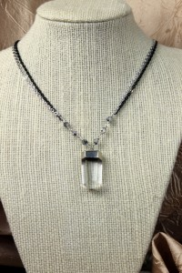 Quartz pendant on silver necklace