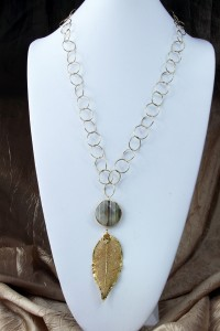 Sparkly quartz and gold leaf pendant on long chain