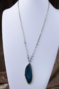Teal agate slice pendant on long gold chain