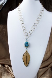 Turquoise and gold leaf pendant on long gold chain