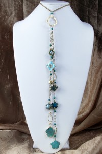 Turquoise flower fantasy lariat on gold chain